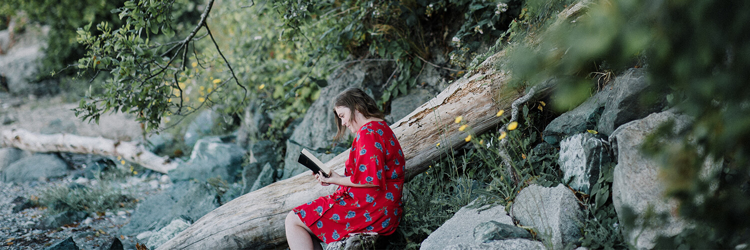 Woman in red dress reading