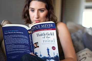 Woman reading Battlefield of the Mind