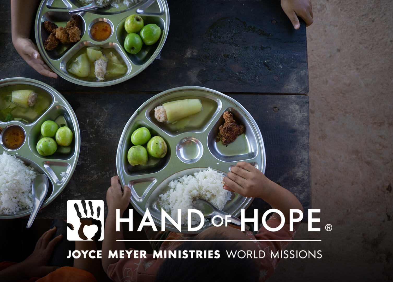 Hand of Hope Logo - Child eating food.